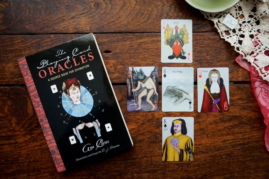 Playing Card Oracles Book with Alchemy Edition Deck which are playing cards for card reading and cartomancy by CJ Freeman and Ana Cortez
